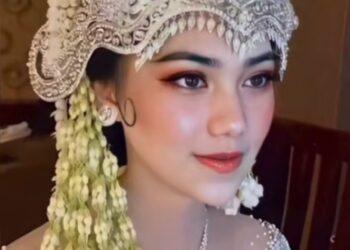 Edit foto jadi pengantin seperti asli yang viral di TikTok pakai aplikasi Tempo./hasil tangkap layar akun TikTok @iniakuloh__/TikTok/ayobandung